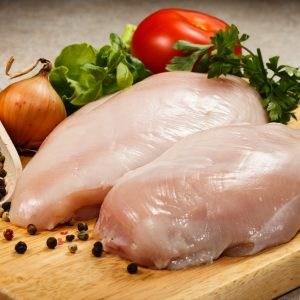 15426265 - raw chicken breasts on cutting board